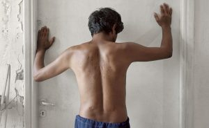GREECE. 2005. Lavrio Detention Center: This Afghani man resisted conscription by the Taliban, and was consequently tortured. He is now being detained Greece as an illegal immigrant.