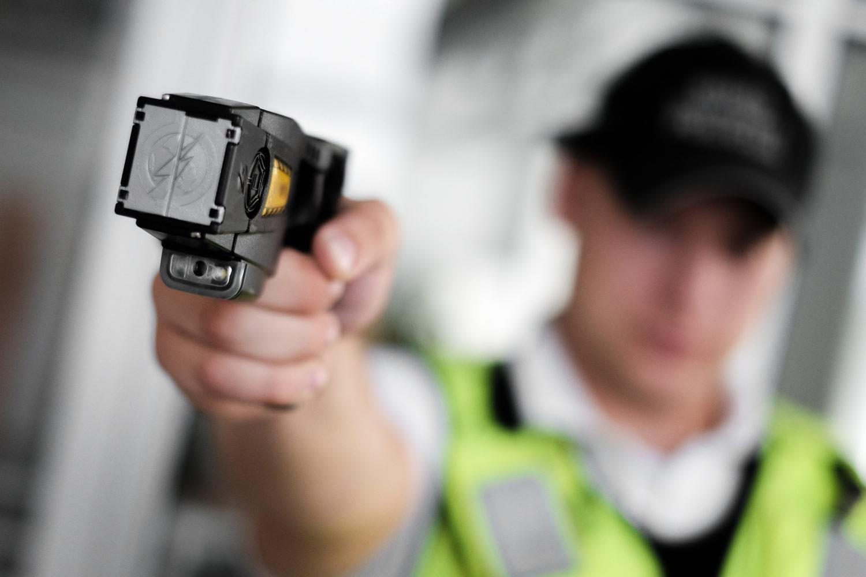 UK policeman with taser gun