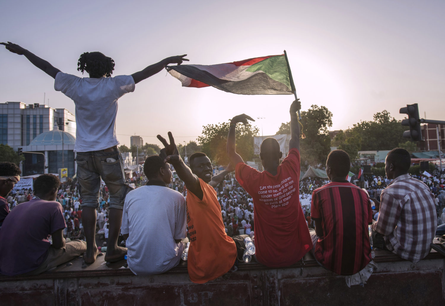 Protesters holding flags in Sudan