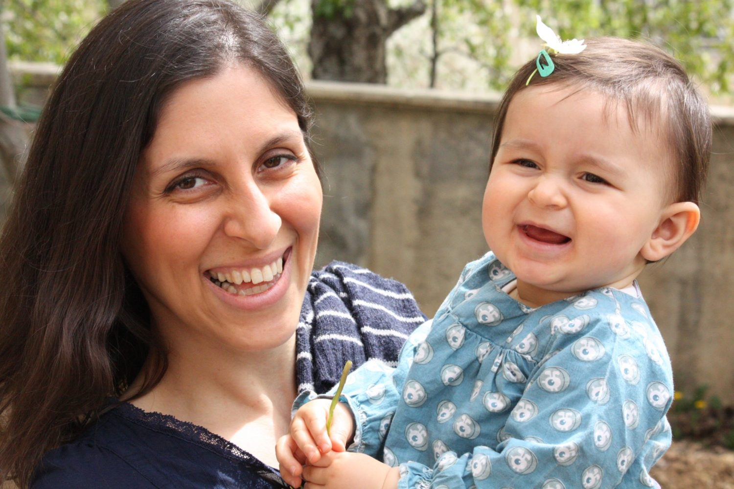 Nazanin and her daughter Gabriella laughing.
